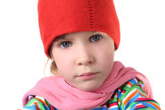 Serious girl in warm hat and scarf Royalty Free Stock Image