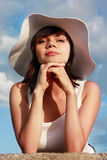 Serious girl in white hat Royalty Free Stock Image