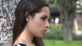 Serious Girl. A young attractive Hispanic female teen stock footage