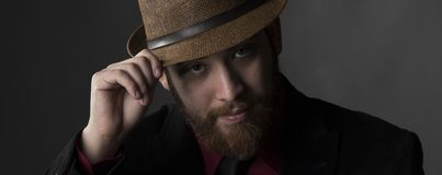 Serious Goatee Man Face with Brown Hat Stock Photography