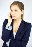Serious gorgeous blond business woman on the phone Stock Images