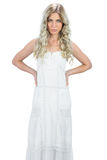 Serious gorgeous model in white dress posing Royalty Free Stock Images