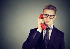 Serious offended business man having unpleasant phone call conversation. Serious grumpy offended business man having unpleasant phone call conversation Royalty Free Stock Photos