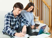 Serious guy and girl doing homework. At table royalty free stock photo