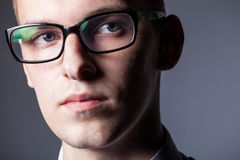 Serious guy in glasses close up Royalty Free Stock Images
