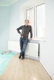 Serious guy on new flooring Royalty Free Stock Images