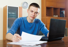 Serious guy staring  documents Stock Image