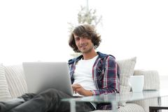 Serious guy working sitting near the desktop. Life style. photo with copy space Royalty Free Stock Image