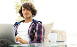 Serious guy working sitting near the desktop. Life style. photo with copy space Royalty Free Stock Photos