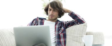 Serious guy working sitting near the desktop. Life style. photo with copy space Royalty Free Stock Images