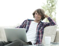 Serious guy working sitting near the desktop. stock images