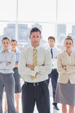 Serious handsome businessman with his team Royalty Free Stock Photography