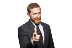 Serious handsome businessman pointing finger to you. Royalty Free Stock Image