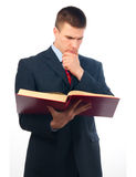 Serious Handsome Businessman Reading The Book Stock Photos