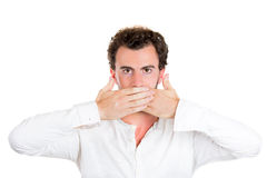 Serious handsome man covering his mouth, speak no evil concept Stock Image