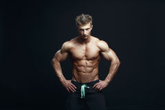 Serious handsome muscular bodybuilder Royalty Free Stock Image