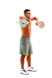 Serious handsome sportsman lifting up barbell Stock Images