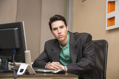 Serious handsome young businessman sitting in the Stock Photography