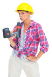 Serious handy woman with a power drill Stock Photography