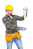 Serious handyman using spirit level Royalty Free Stock Photography