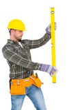 Serious handyman using spirit level Stock Photos