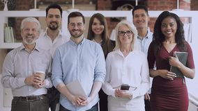 Serious happy professional business team standing in office, video portrait