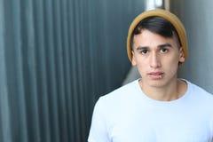 Serious hip Latino teen outdoors close up Stock Photography
