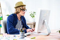 Serious hipster businessman working on computer Royalty Free Stock Images