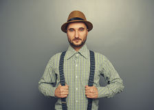 Serious hipster man. Portrait of serious hipster man over grey background Stock Image