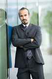 Serious Hispanic Businessman Stock Photo