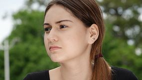 Serious Hispanic Female. A young female hispanic teen Royalty Free Stock Photos