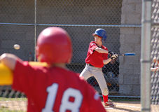 Serious Hit. Little League baseball player ready to hit the ball with all his might.  Batter Up Royalty Free Stock Image