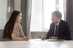 Free Serious Hr Employer Listening To Asian Applicant At Job Interview Stock Image - 153895771