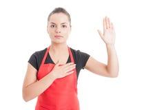 Serious hypermarket employee swearing something Stock Images