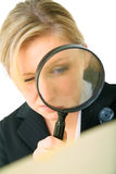 Serious Investigator Examine Folder. Serious female investigator look at folder through loupe stock photo