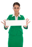 Serious isolated business woman in green holding message board i Royalty Free Stock Images