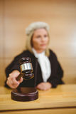Serious judge with a gavel wearing robes and wig Royalty Free Stock Image