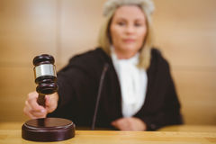 Serious judge with a gavel wearing robes and wig Royalty Free Stock Photography
