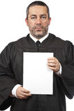 Serious judge holding the blank card Royalty Free Stock Image