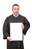 Serious judge holding the blank card Stock Photography
