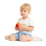 Serious kid eating healthy food Stock Image