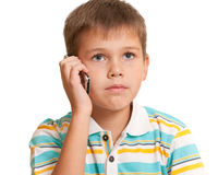 Serious kid talking on the phone Royalty Free Stock Image
