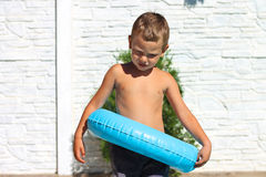 Serious kid wants to jump into a  pool Stock Photo