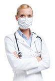 Serious lady doctor in respirator Stock Image