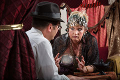 Serious Lady Fortune Teller Royalty Free Stock Photography