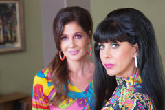 Serious Lady with Friend. Serious Caucasian women in paisley with cute friend Royalty Free Stock Photo