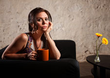 Serious Lady on Sofa Stock Photography