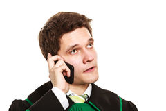 Serious lawyer make a phone call. Technology and career legal advice. Young male lawyer make phone call talk help give advice Royalty Free Stock Photos