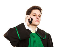 Serious lawyer make a phone call. Technology and career legal advice. Young male lawyer make phone call talk help give advice Stock Image
