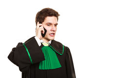 Serious lawyer make a phone call. Technology and career legal advice. Young male lawyer make phone call talk help give advice Royalty Free Stock Images